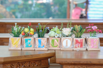 Welcome flower / Decoration flower with word welcome on the table.