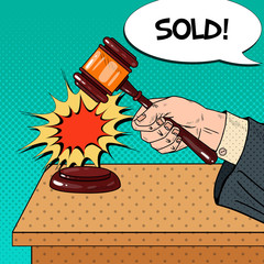 Pop Art Hand Hitting Wooden Gavel in a Auction. Vector illustration