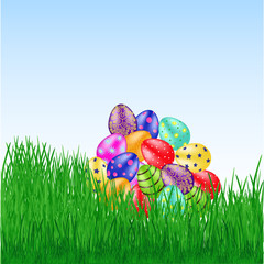 Bunch of easter eggs on the grass
