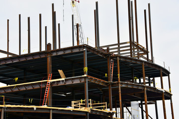 Steel and concrete multi story commercial building under construction.