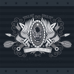 Skull front view with a lower jaw between wings, ribbons and cross vintage weapons. Vintage label isolated on blackboard