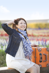 Mid Adult Woman Traveling in Countryside