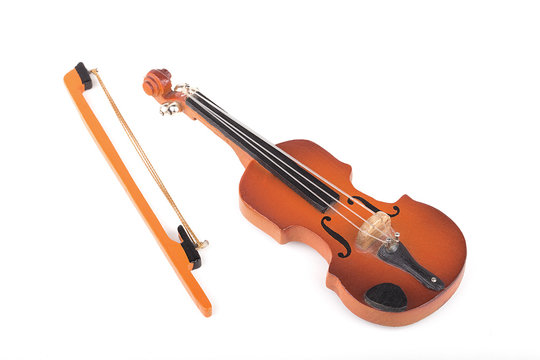 Miniature violin isolated on white.