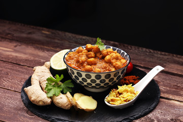 Chana Masala indian dish spicy Chick Peas also known as Chola Masala or Chole served in a white bowl