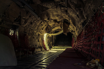 Interiors of abandoned airplane, old crashed aircraft, plane wreck in graveyard