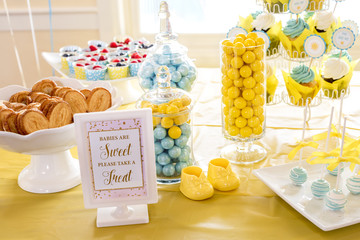 Sweet treats and sign at a Baby Shower