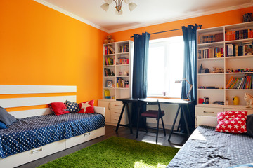 Kids bedroom in orange and blue colors