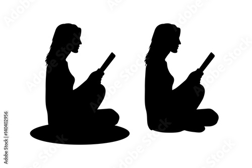 girl sitting reading silhouette