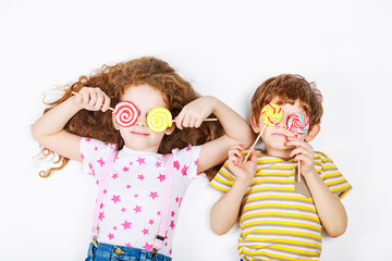Funny children hold candy lollipop. Healthy lifestyle concept.