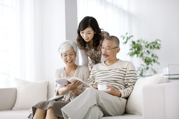 Family in living room, parents sitting on sofa
