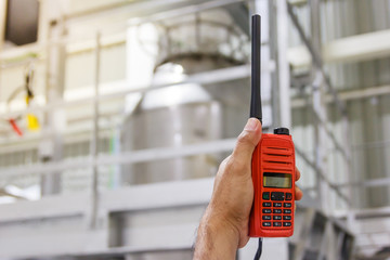 Handheld walkie talkie communication radio for communications at construction site with copy space and text.