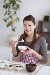 Mid Adult Woman Having Breakfast