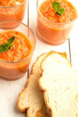 Tomato soup gazpacho and bread on the table.