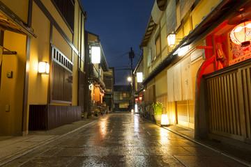 Street passing through buildings at night