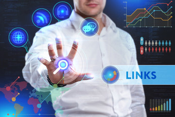 Business, Technology, Internet and network concept. Business man working on the tablet of the future, select on the virtual display: LINKS