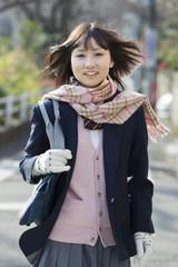 High school girl walking in the street