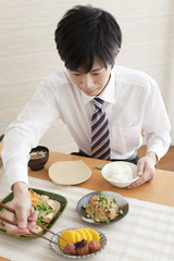 Young Man Eating Breakfast