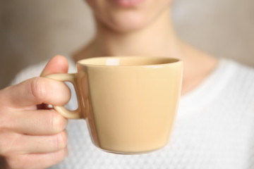 Blank color cup in hand, closeup