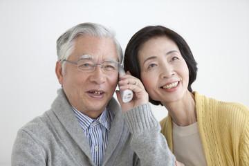 Senior couple talking on the phone