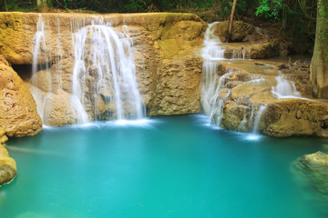 waterfall with clear blue or green emerald water and rock for relax with tree in the jungle at Huay Mae Khamin waterfall for nature landscape and background