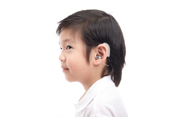 Asian child with hearing aid