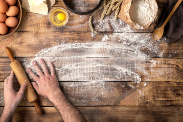 Wall Mural - Baker preparing to knead the dough, top view