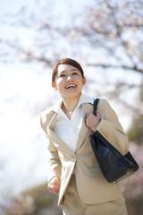A Business Woman Running