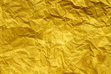wrinkled yellow paper texture , copy space