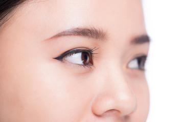 Asian eye woman eyebrow eyes lashes over white.