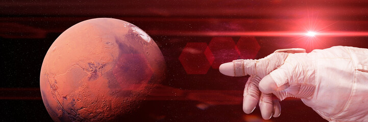 astronaut pointing to Mars