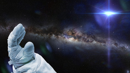 astronaut, bright nearby star and the local a galaxy