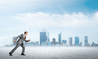 King businessman in elegant suit running and business center at background