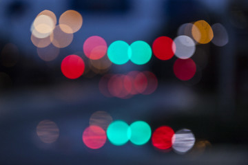 abstract traffic lights out of focus against blue background
