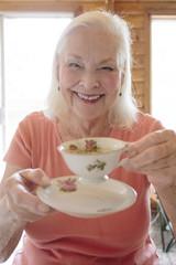 Portrait of a smiling senior woman having tea
