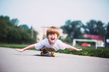 Funny boy on a skateboard.