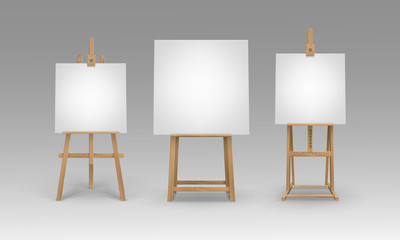 Set of Brown Sienna Wooden Easels with Mock Up Empty Blank Canvases Isolated on Background
