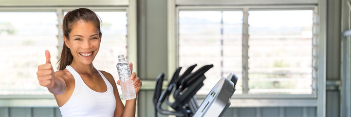 Happy girl drinking water at fitness center banner
