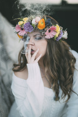 Close up of young woman smoking a joint