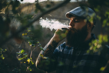 Close up of man smoking a joint outdoors