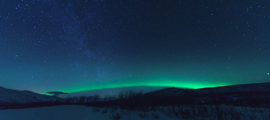 Photo sur Aluminium Aurore polaire Panorama with Milky way and Northen lights Aurora.