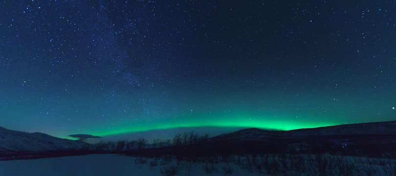 Panorama with Milky way and Northen lights Aurora.