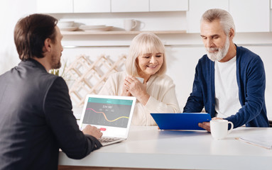 Finance advisor working with aged couple in the house