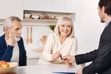 Social security advisor making agreement with elderly couple