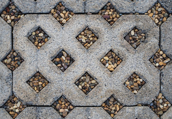 Concrete block with small stones on walk path, top view