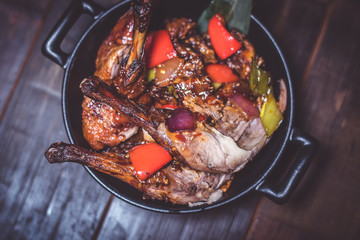 Fried duck with vegetables in a pan