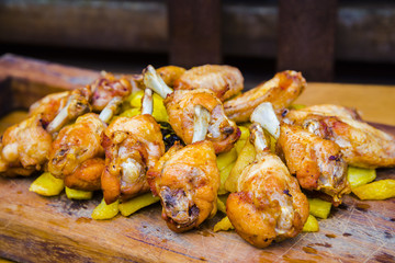 Roasted chicken wings and thighs dish