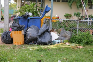 Pile black garbage bag roadside in the city