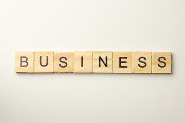 Text wooden blocks spelling the word BUSINESS on white background