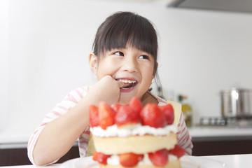 Girl tasting cake