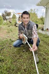 Gardener measuring